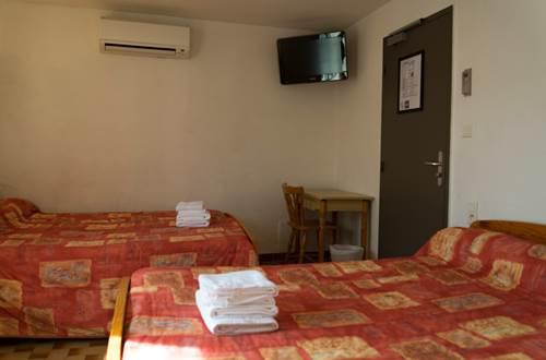 HOTEL ESCALE chambre 2 ©