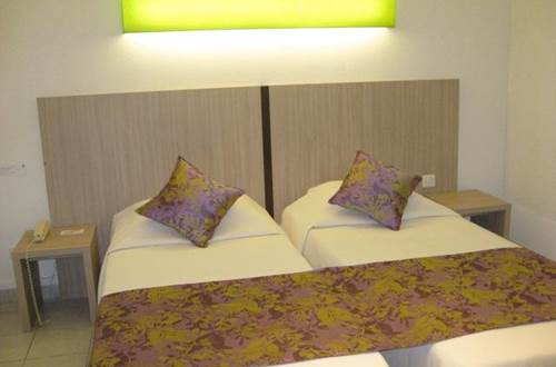Hôtel La Taverne de Sophie Uzès Chambre violet © Hôtel La Taverne de Sophie